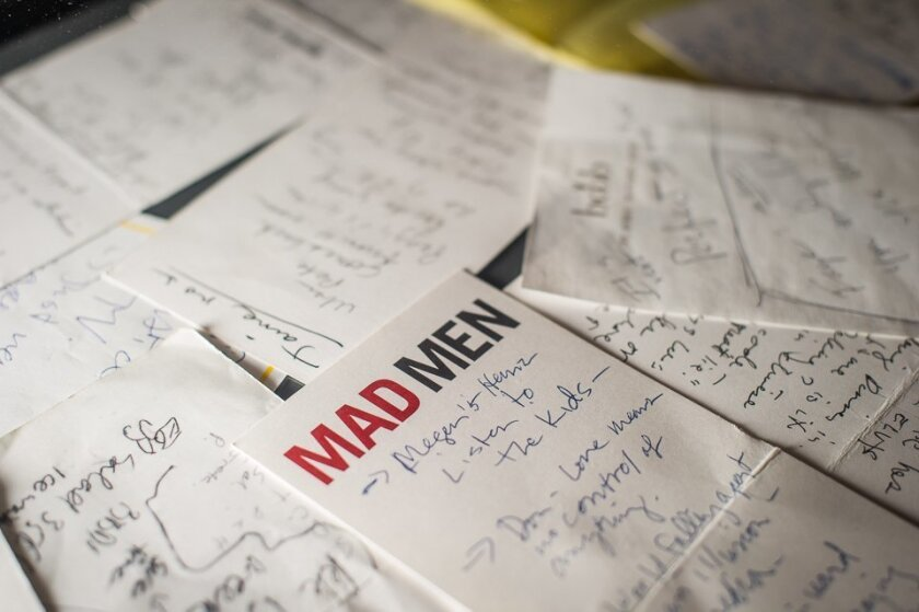 """In this March 10, 2015, photo, notes and storylines for """"Mad Men,"""" scribbled by Matthew Weiner, are displayed as part of the exhibition, """"Matthew Weiner's Mad Men,"""" at the Museum of the Moving Image in New York. The exhibit runs through June 14. The final episodes of the series will begin on April"""