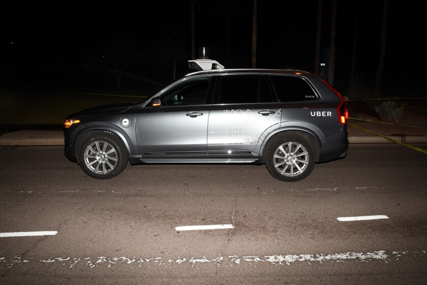 FILE - This March 18, 2018 file image provided by the Tempe Police Department shows an Uber SUV after hitting a woman in Tempe, Ariz. Documents released Tuesday, Nov. 5, 2019 by the National Transportation Safety Board raise questions about whether a self-driving Uber SUV that ran down a pedestrian last year should have been allowed on public roads for test purposes. (Tempe Police Department via AP, File)