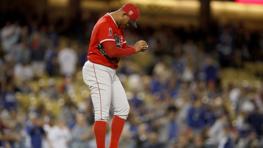 LOS ANGELES, CA-MARCH 27, 2018: Angels starting pitcher JC Ramirez looks down at the mound after giv