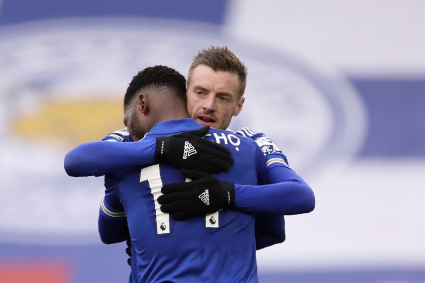 Leicester's Kelechi Iheanacho celebrates with Jamie Vardy, right, after scoring the opening goal during the English Premier League soccer match between Leicester City and Sheffield United at the King Power Stadium in Leicester, England, Sunday, March 14, 2021. (Alex Pantling/Pool via AP)