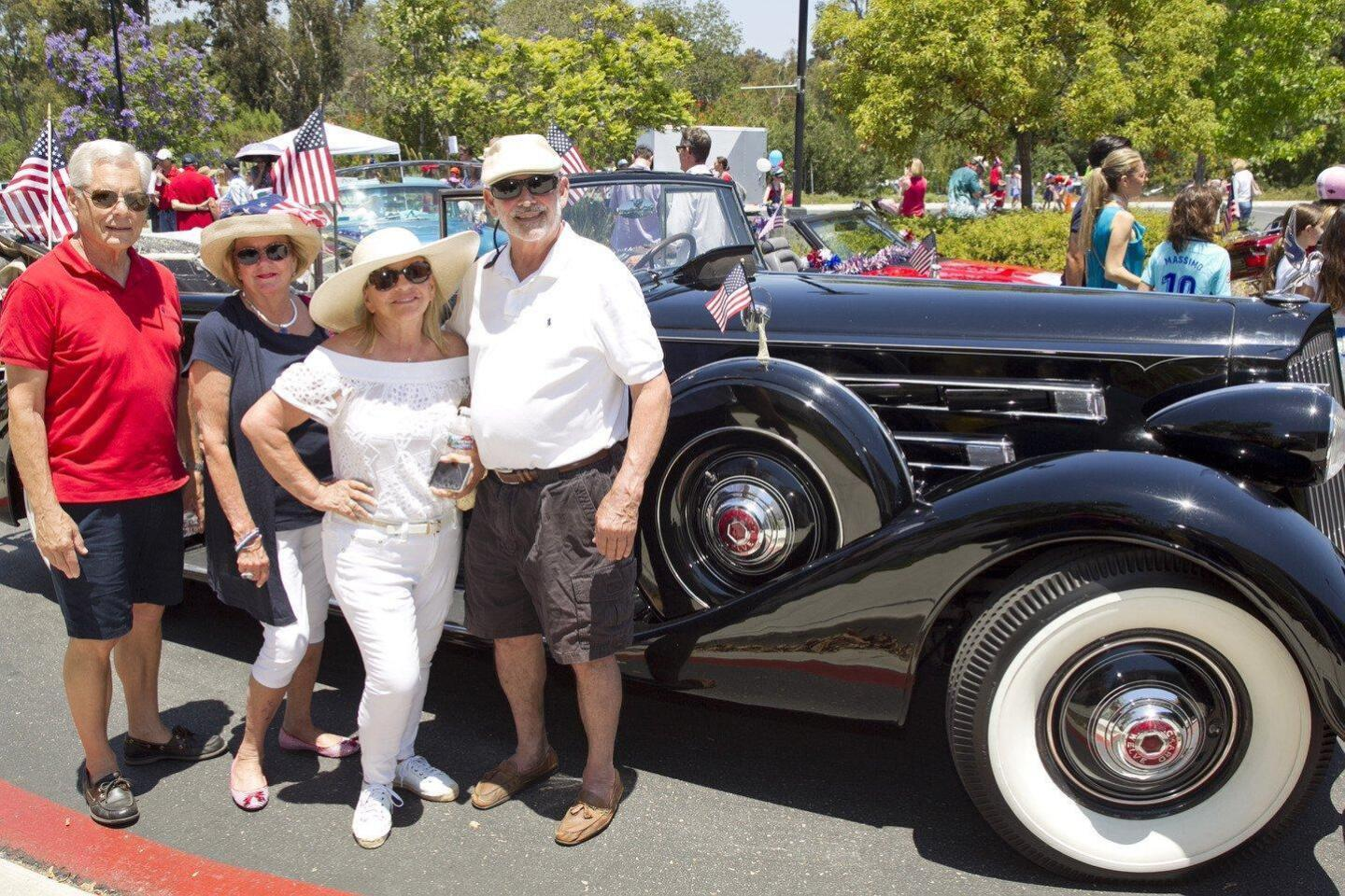 Bob and Mary Ellen Guy, Vicki and Carl Zeiger with a 1936 Packard Convertible Sedan