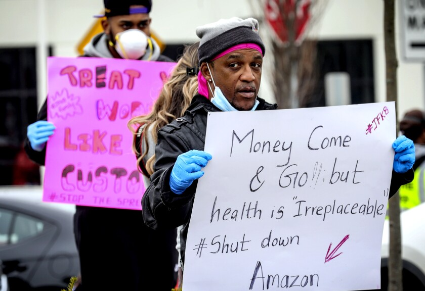 Workers at an Amazon fulfillment center in Staten Island, N.Y., protest conditions in the company's warehouse
