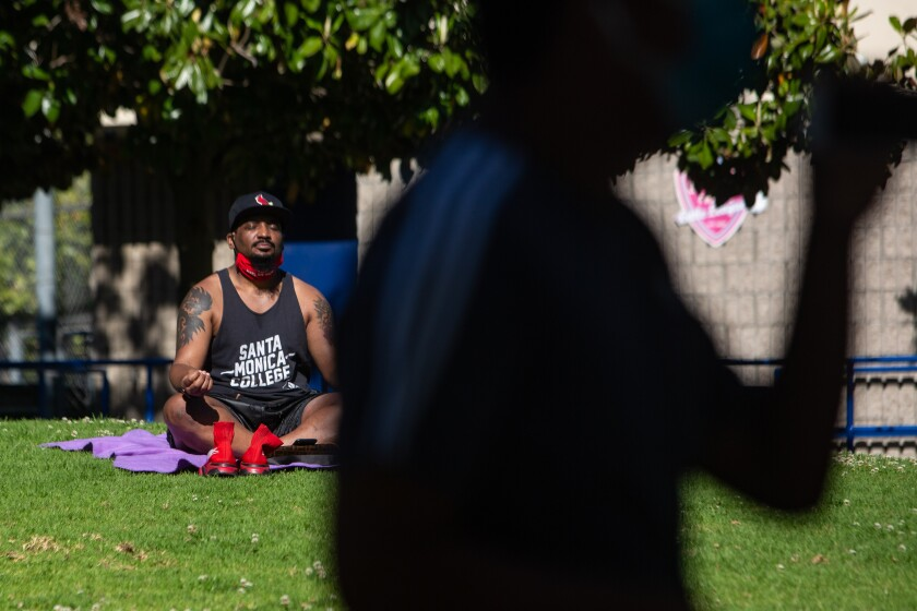 Anthony Cherro of Los Angeles relaxes in La Cienega Park in Los Angeles