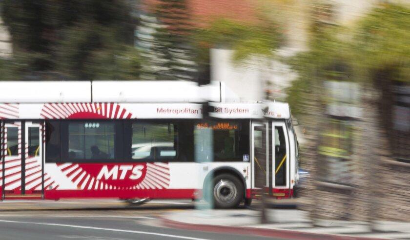 A MTS bus headed northbound on 54th street crossing El Cajon Blvd.