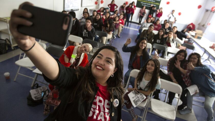 Assemblywoman Wendy Carrillo takes a group selfie with student group La Resistencia as they hold an event for International Women's Day at the Los Angeles Leadership Academy.