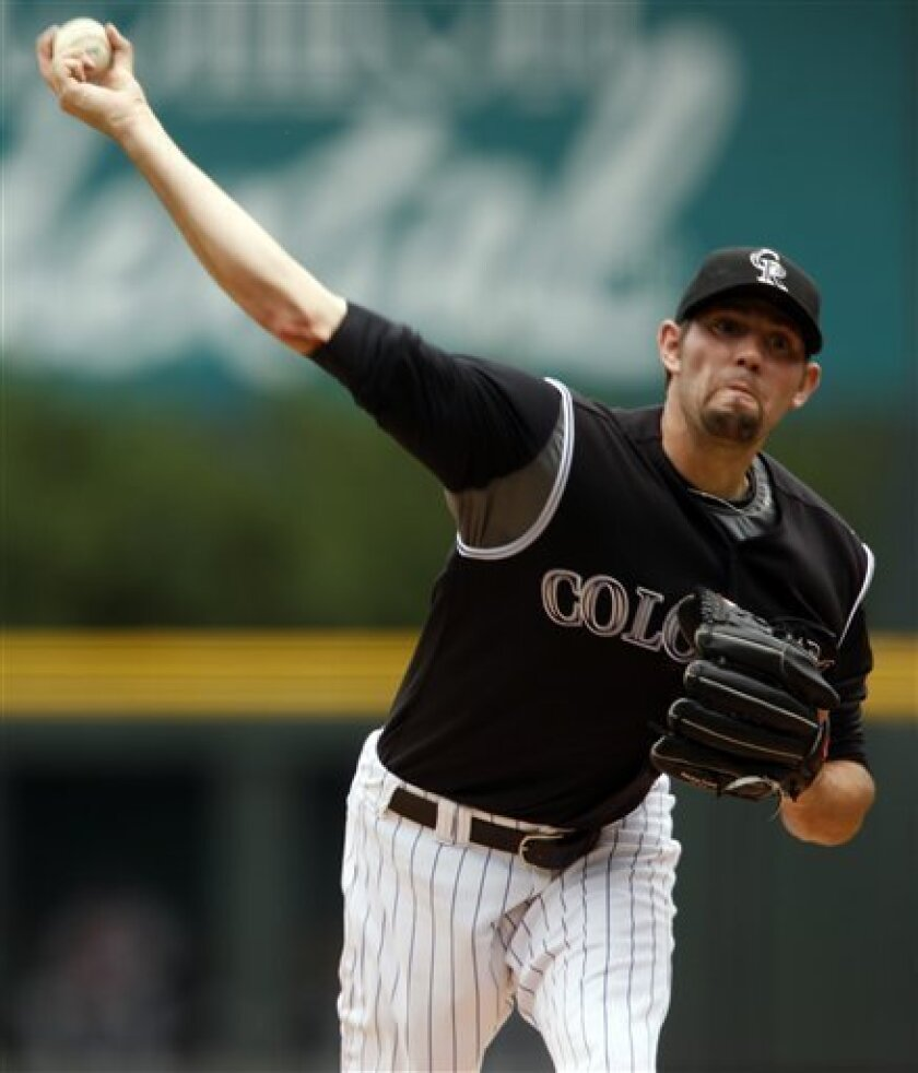 Colorado Rockies starting pitcher Jason Hammel works against the Atlanta Braves in the first inning of a baseball game in Denver, Sunday, July 12, 2009. (AP Photo/David Zalubowski)