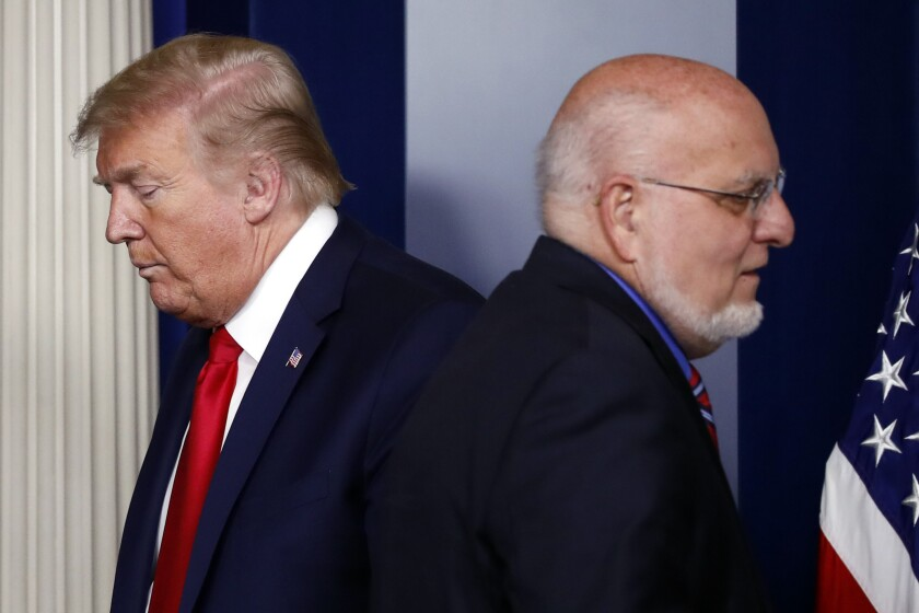President Trump and Robert Redfield, director of the Centers for Disease Control and Prevention, at the White House in April.