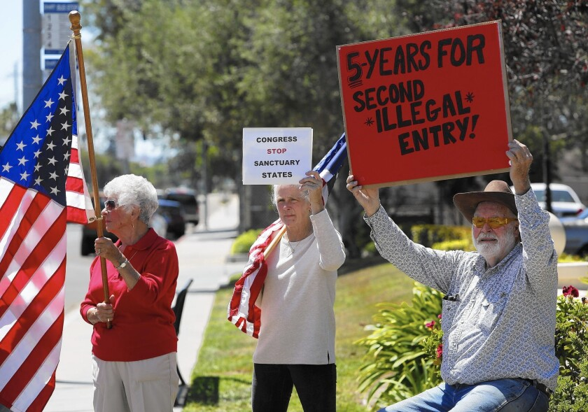 Protestors wanting illegal immigrants deported demonstrate near the Santa Maria Courthouse on Aug. 13.