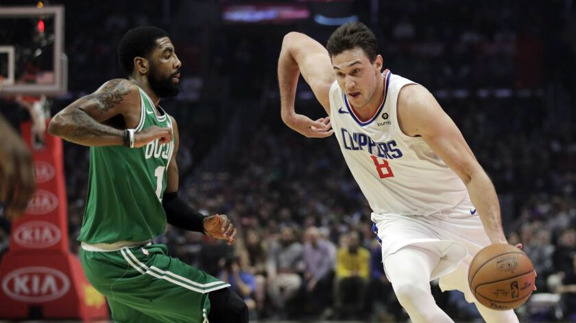 The Clippers' Danilo Gallinari drives the ball past the Boston Celtics' Kyrie Irving during the first half on March 11, 2019, in Los Angeles.