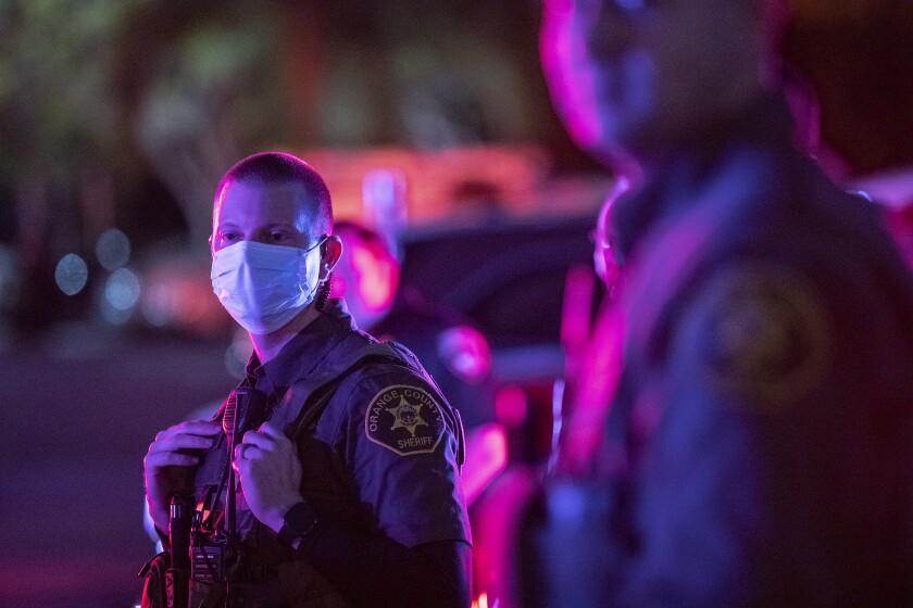 An Orange County sheriff's deputy wearing a face mask