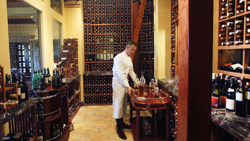 Addison executive chef William Bradley in the dining room cellar that holds about 3,000 of the restaurant's world-class 14,000-bottle collection