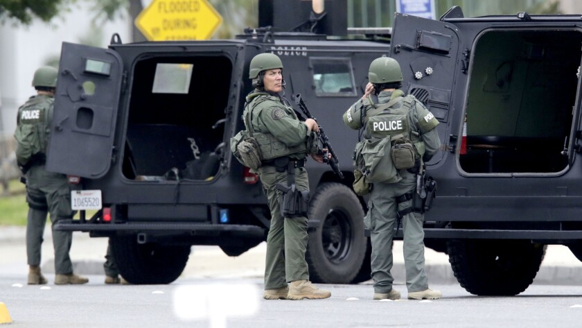 SWAT officers respond to the scene of the search for a burglary suspect police believed might have been armed.