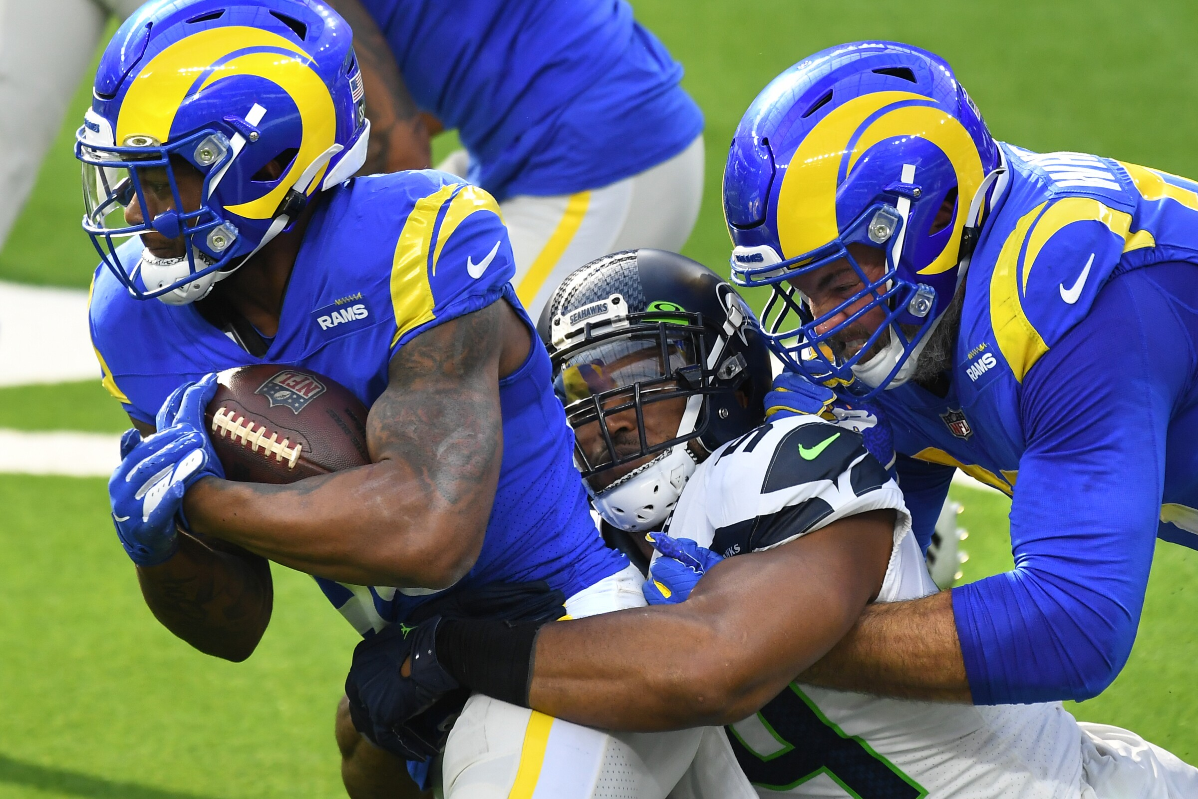 Rams running back Cam Akers gets a little help from offensive lineman Andrew Whitworth to pick up yards.