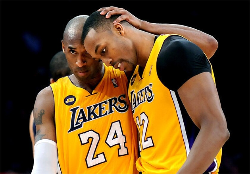Lakers guard Kobe Bryant encourages teammate Dwight Howard.
