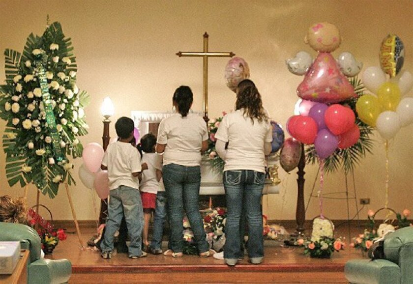 Friends and family members of Alitza Ortiz Sanchez, a 5-year-old Otay Mesa girl who died Saturday of swine flu, visited her coffin yesterday at a funeral home in Tijuana. (Sean M. Haffey / Union-Tribune)