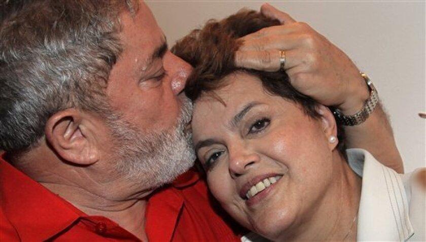 In this photo provided by Brazil's Presidency, Brazil's President Luiz Inacio Lula da Silva, left, kisses Brazil's newly elected leader Dilma Rousseff, at the Alvorada palace, in Brasilia, Brazil, Monday, Nov. 1, 2010. (AP Photo/Brazil's Presidency, Ricardo Stuckert) NO SALES