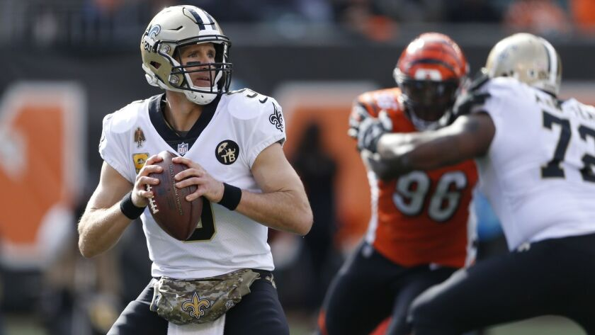 New Orleans Saints quarterback Drew Brees looks to pass in the first half of an NFL football game against the Cincinnati Bengals, Sunday, Nov. 11, 2018, in Cincinnati.