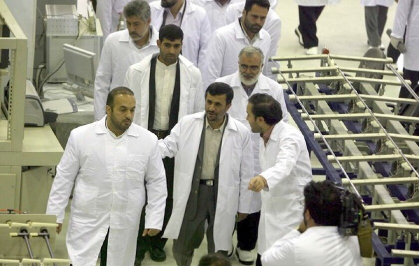 President Mahmoud Ahmadinejad, center front, tours the factory in Esfahan that will produce uranium fuel pellets for use at the Arak research reactor.
