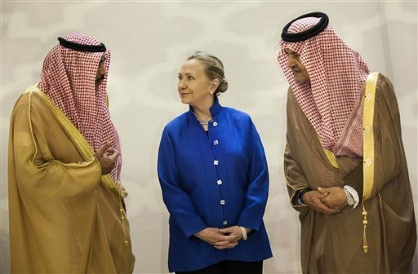 Saudi Foreign Minister Prince Saud Al-Faisal, right, U.S. Secretary of State Hillary Clinton and Kuwaiti Foreign Minister Sheikh Sabah Khaled al-Hamad Al-Sabah chat prior to a group photo before a US- Gulf Cooperation Council forum at the Gulf Cooperation Council Secretariat in Riyadh, Saudi Arabia