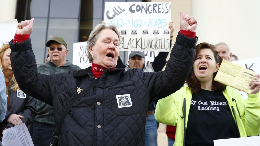 Patty Amburgey, of Letcher, Ky., left and Linda Adams, of Pikeville, Ky., both members of the Black