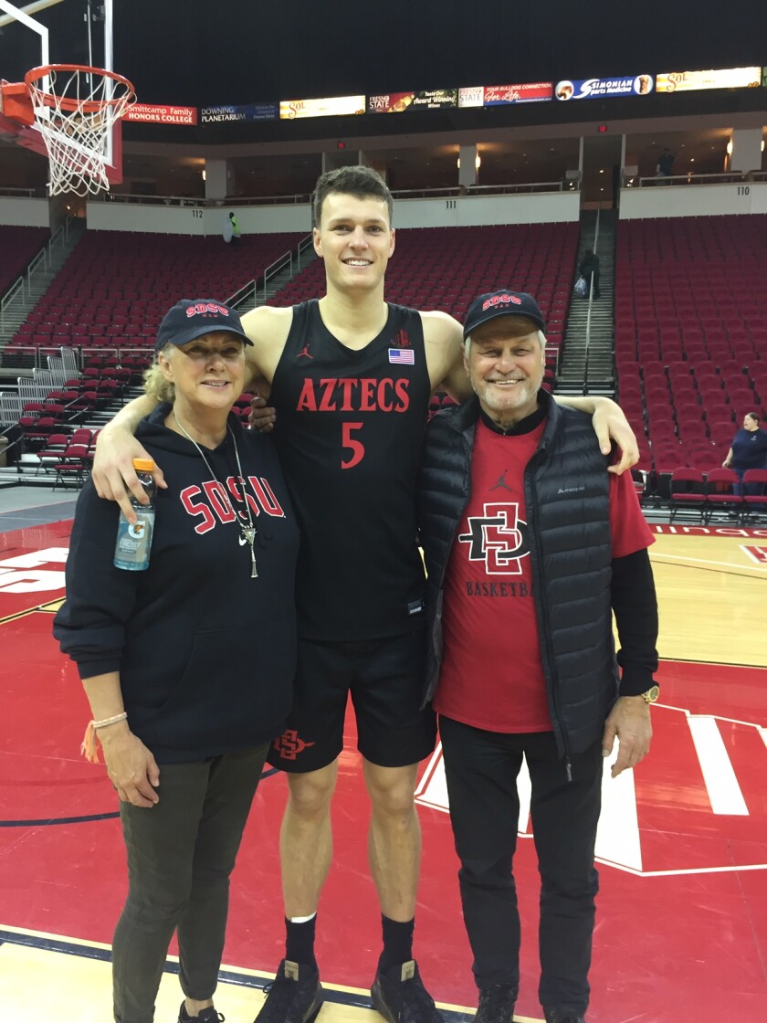Jenny (left) and Clem (right) Wetzell with their son, Yanni, at Fresno State's Save Mart Center on Jan. 14.