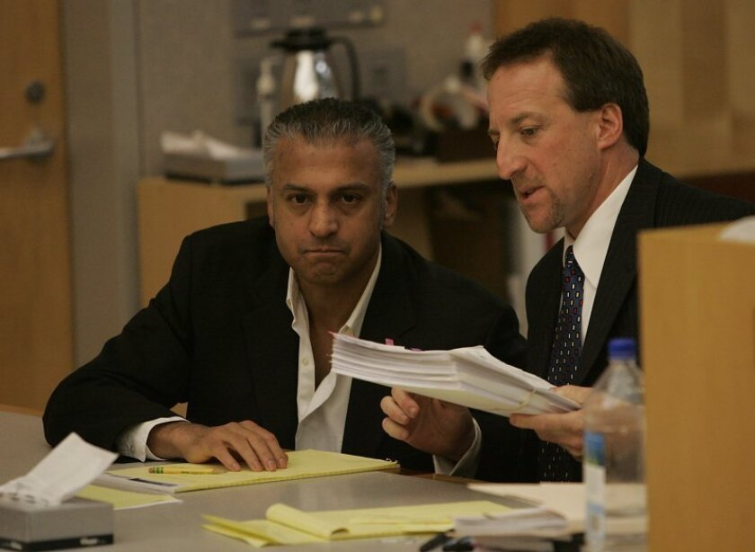 Shelly Malil (left) listens to his attorney, Steve Meister, at a Vista courtroom hearing at which a judge determined the actor should stand trial on charges including premeditated attempted murder in the stabbing of his former girlfriend.