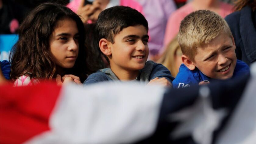Kids in the audience listen to U.S. Democratic presidential nominee Hillary Clinton speak at a campaign rally in Cedar Rapids, Iowa, U.S. October 28, 2016.
