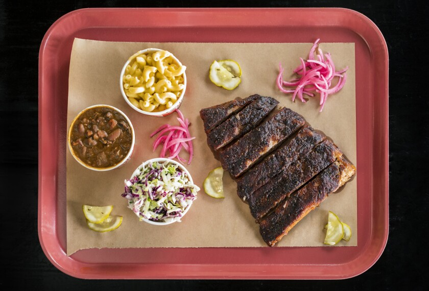 Spare ribs, coleslaw, beans and mac and cheese from Slab Barbecue