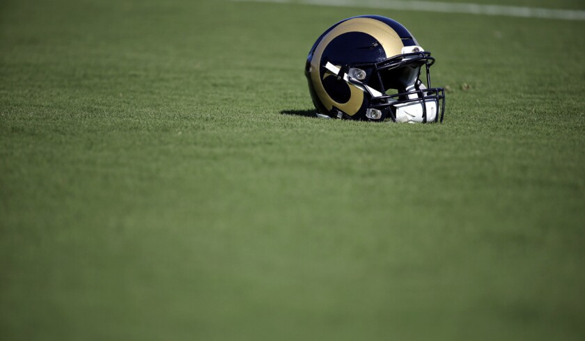 A Rams helmet sits on the turf during training camp at the NFL football team's practice facility.