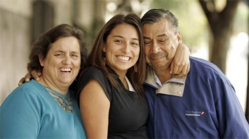 CHANGE: Damaris Pereda, who is bilingual, is flanked by her parents, Rosa and Manuel Pereda of Huntington Park.