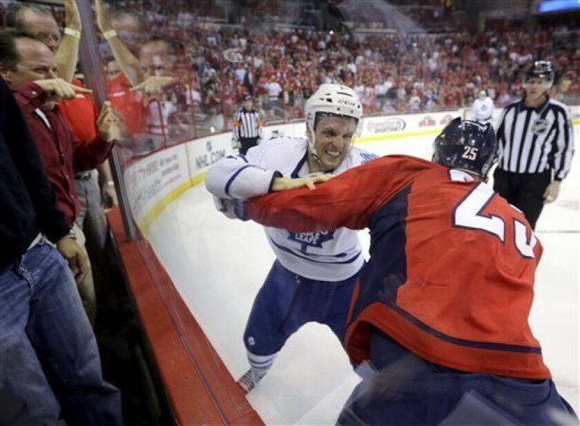 Toronto Maple Leafs center Jay McClement (11) and Washington Capitals left wing Jason Chimera (25) fight in the first period of an NHL hockey game Tuesday, April 16, 2013 in Washington. (AP Photo/Alex Brandon)