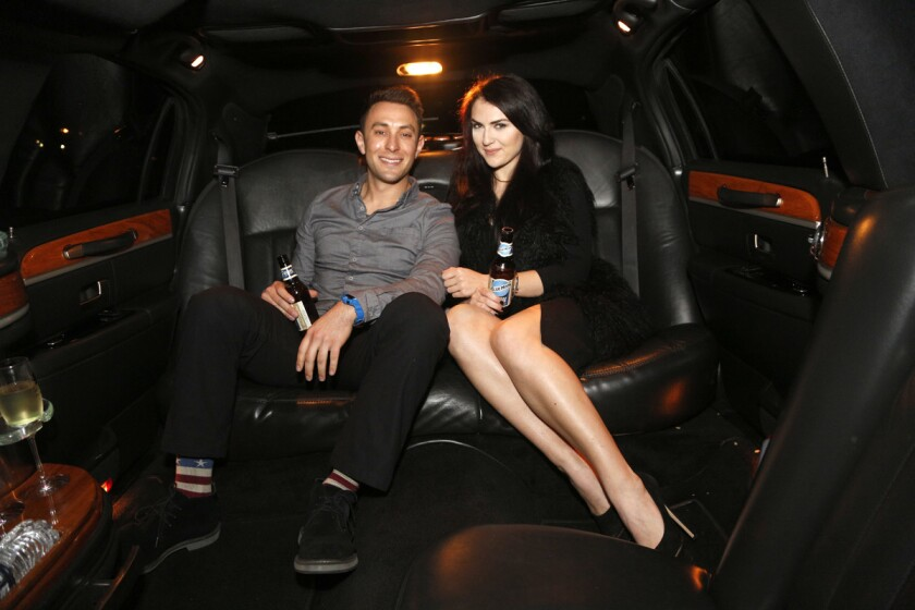 Blind daters Scott Schindler and Zlata Sushchik have some fun in the limo while drinking Blue Moon Belgian White.