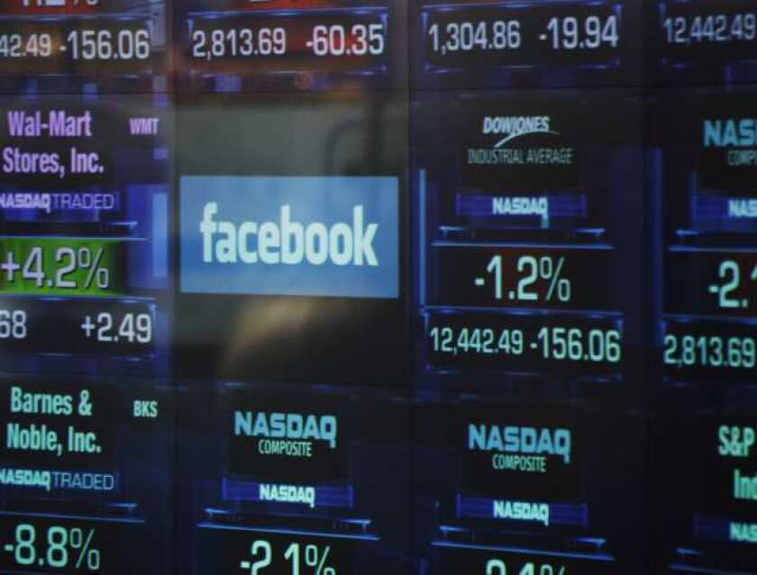 The Facebook logo appears on a display inside the NASDAQ Marketsite in Times Square.