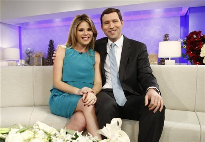 """This image released by NBC shows Jenna Bush Hager, left, and her husband Henry Hager as they appear on NBC News' """"Today"""" show, Wednesday, Dec. 12, 2012 in New York where they announced they were expecting their first child. The 31-year-old made the announcement on NBC's """"Today"""" show, where she is a contributing correspondent. Hager, the twin daughter of former President George W. Bush, and her husband, Henry, have been married for four years. (AP Photo/NBC, Peter Kramer)"""