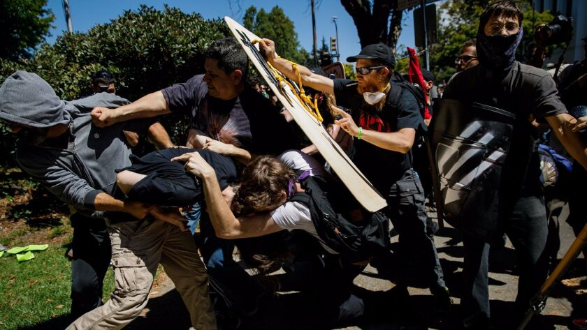 BERKELEY, CALIF. -- SUNDAY, AUGUST 27, 2017: Demonstrators clash as as they beat up a man during cou