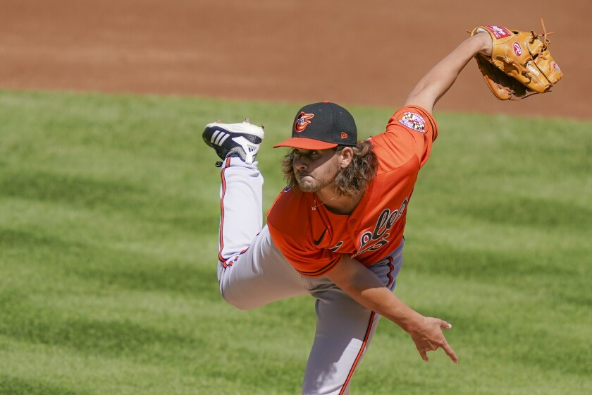 Baltimore Orioles starting pitcher Dean Kremer throws in the first inning of a baseball game against the New York Yankees, Saturday, Sept. 12, 2020, in New York. (AP Photo/John Minchillo)