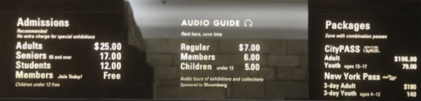 The board at the Metropolitan Museum of Art in New York displays admission fees that are recommended but not mandatory. A lawsuit contends that many visitors to the museum don't realize that.