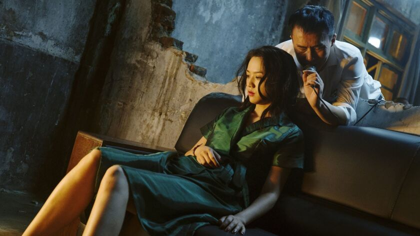 "(L-R) - Wei Tang and Yongzhong Chen in a scene from ""Long Day's Journey Into Night."" Credit: Liu Hon"