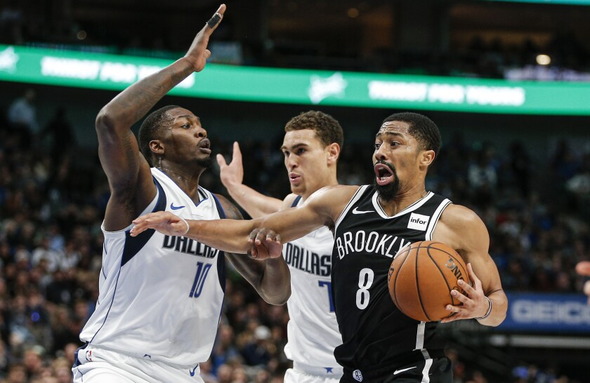 Mavericks forward Dorian Finney-Smith (10) and center Dwight Powell cut off a drive by Nets guard Spencer Dinwiddie during a game Jan. 2, 2020, in Dallas.
