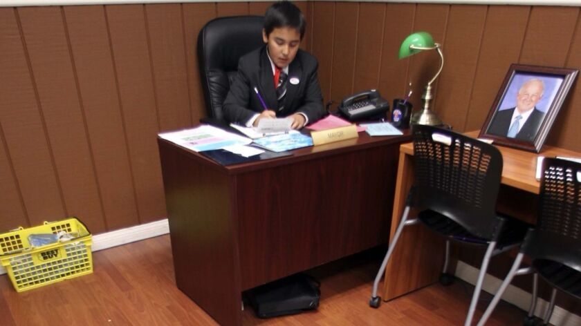 "Junior Achievement operates Biz Town where young students get to practice running a mini-city. In this file photo, a Bernardo Elementary School fifth grader was the ""mayor"" of BizTown for a day. San Diego Junior Achievement also recognizes adults for their business leadership."