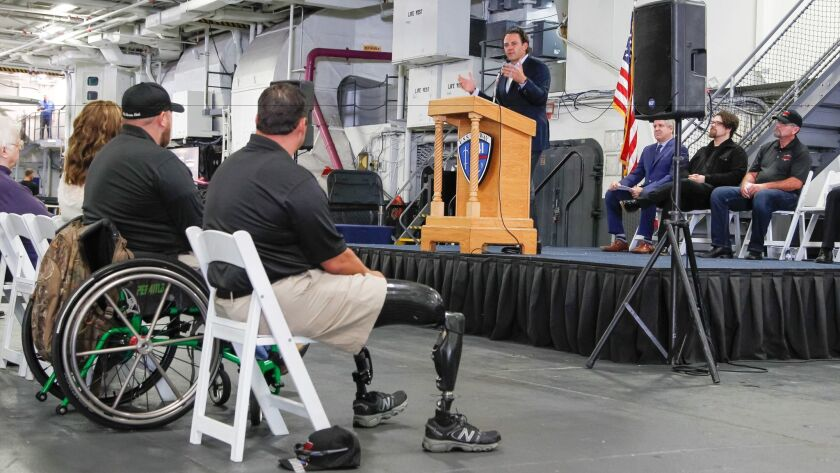 "Nathan Fletcher, founder of The Three Wise Men veterans foundation, speaks to disabled vets and the media about San Diego Opera's ""Soldier Songs"" at a press conference aboard the USS Midway Museum."