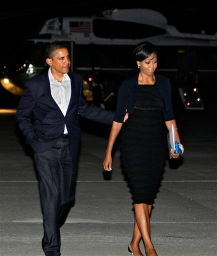 """President Barack Obama and first lady Michelle Obama depart John F. Kennedy International Airport in New York early Sunday, May 31, 2009 after a Saturday night in Manhattan for a private dinner and a Broadway play. The Obamas attended a performance of """"Joe Turner's Come and Gone"""", the August Wilson"""