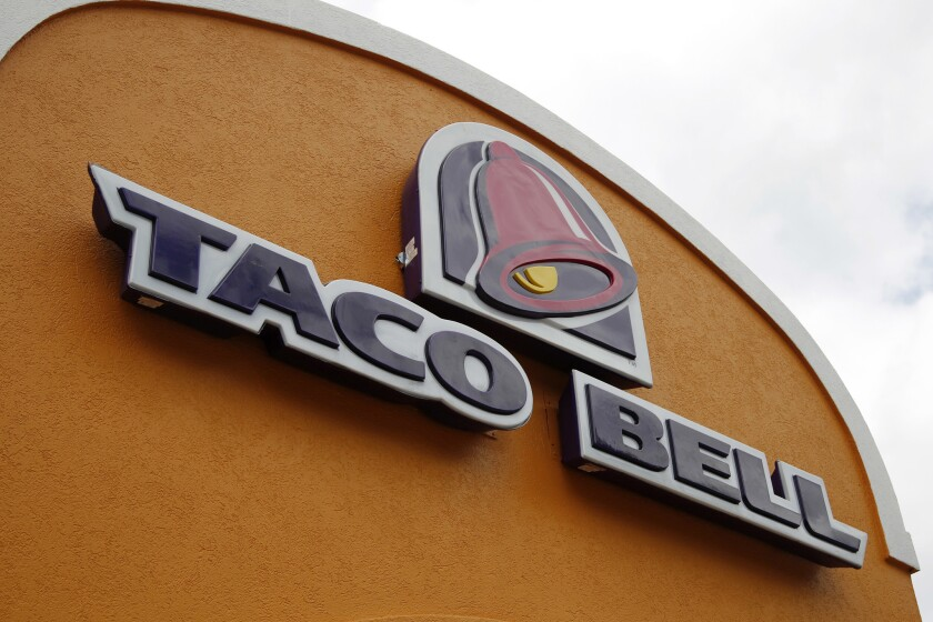 FILE - This Friday, May 23, 2014, file photo, shows the sign at a Taco Bell in Mount Lebanon, Pa. Ta
