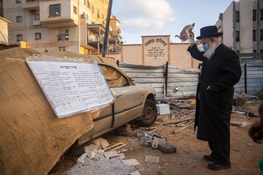 An ultra-Orthodox Jewish man performs a religious ritual in Bnei Brak, Israel.