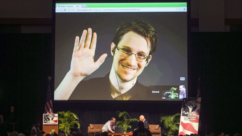 FILE - In this Feb. 14, 2015, file photo, Edward Snowden appears on a live video feed broadcast from