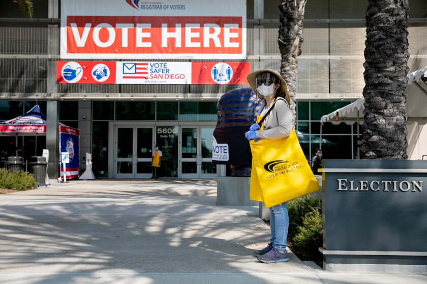 SAN DIEGO, CA - OCTOBER 05: An election worker waits for voters to cast their mail ballots at the  County Registrar of Voters