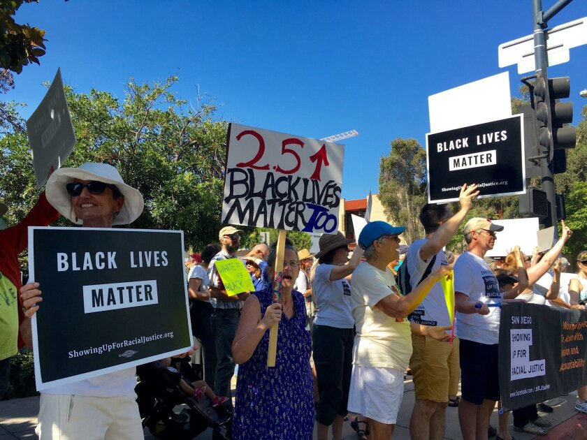 White residents of San Diego demonstrated at police headquarters Thursday to call for racial equality.