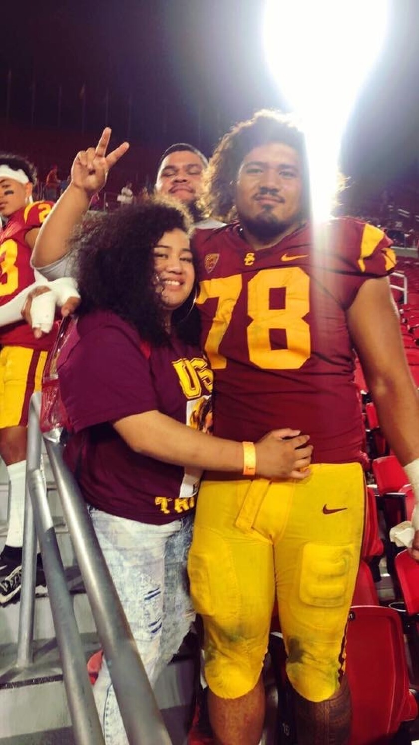 USC defensive lineman Jay Tufele is shown with his sister Noreen after a game at the Coliseum.