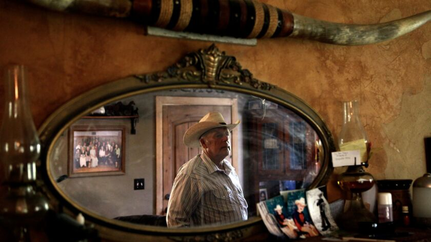 BUNKERVILLE, NV - AUGUST 20, 2013 -- Rancher Cliven D. Bundy, 67, is reflected in a mirror that rest