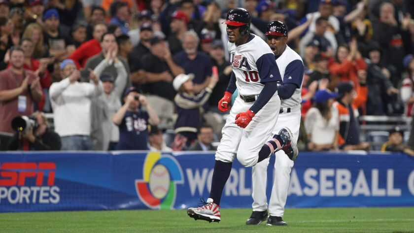Team USA's Adam Jones celebrates his eighth-inning home run after rounding third base during USA's game against Venezuela in the World Baseball Classic at Petco Park in San Diego on Wednesday, March 15, 2017.